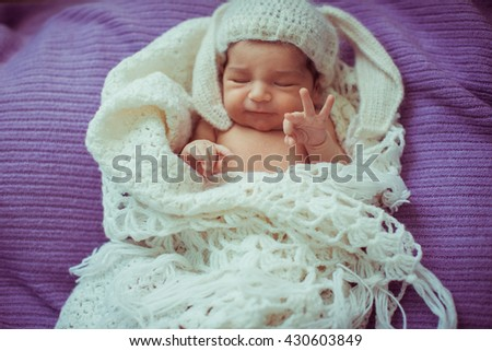 lovely little baby lying in a white scarf - stock photo