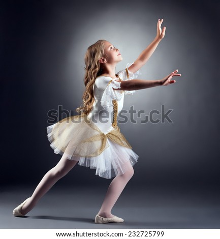 Lovely little ballerina dancing at camera - stock photo