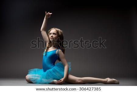 Lovely little ballerina inspired dancing in studio - stock photo