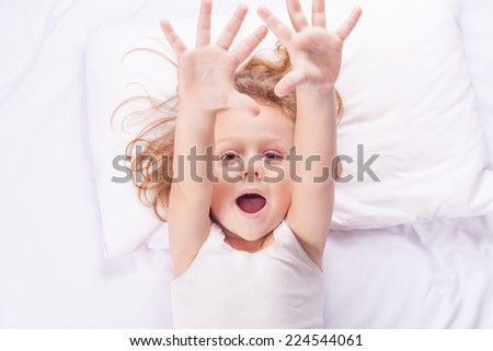 Lovely little boy lying in bed at home - stock photo