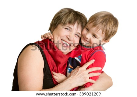 Lovely little boy with his grandmother having fun and happy moments together on a white background - stock photo