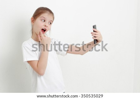 Lovely little girl and mobile phone