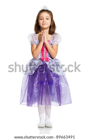 lovely little girl, dressed as a princess, making a wish, isolated on white background