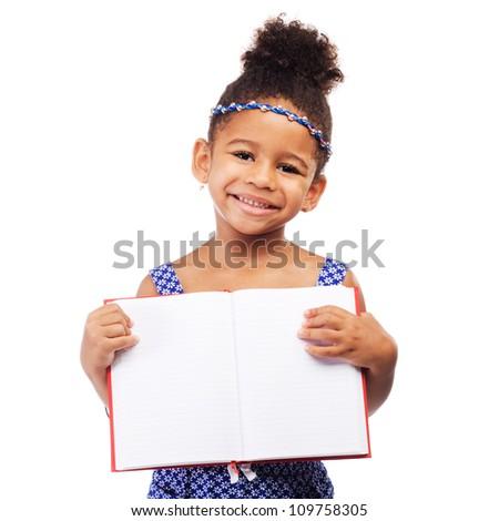 Lovely little girl holding an open notebook - stock photo
