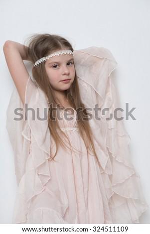 Lovely little girl in a beautiful dress - stock photo