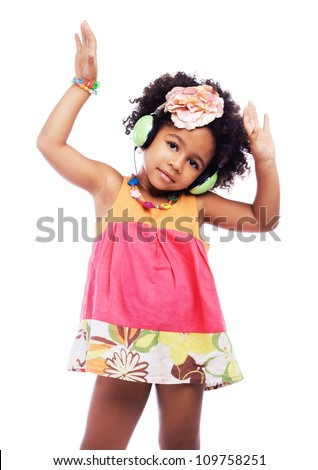 Lovely little girl is dancing in headphones - stock photo