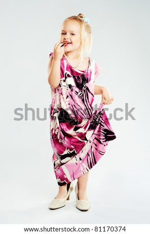 Lovely little girl playing adult fashion model - stock photo
