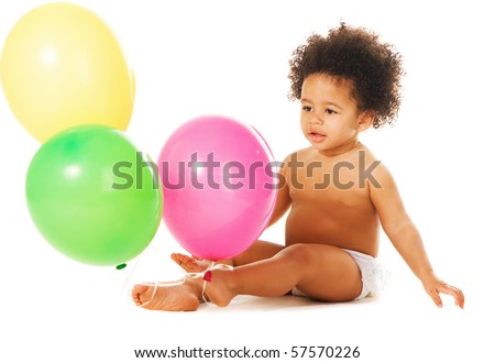 Lovely little girl with colorful balloons sitting on white - stock photo
