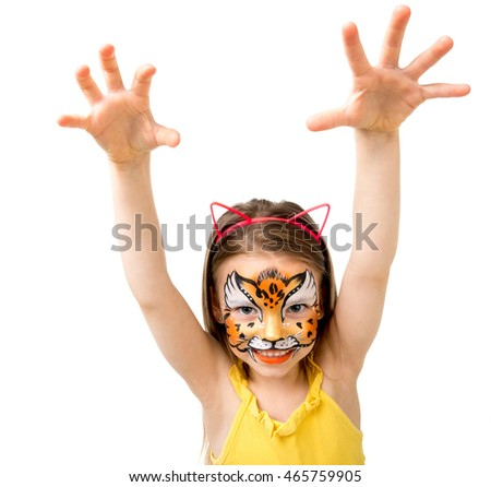 lovely little girl with colorful painted face like tiger making selfie