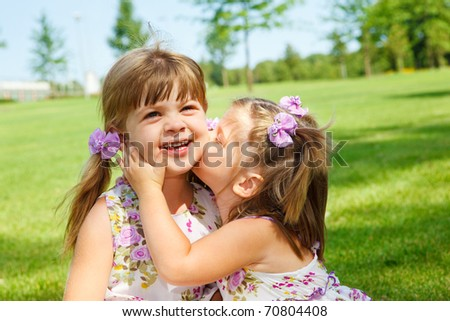 Lovely little sisters - stock photo