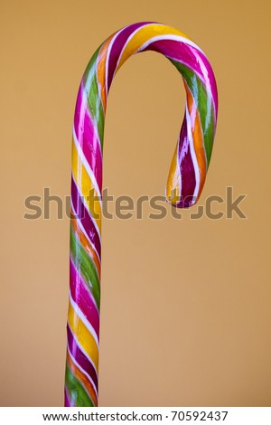Lovely lollipop with colourful stripes - stock photo