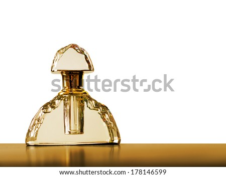 Lovely luxury retro glass perfume bottle on golden and white background