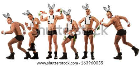 Lovely men in rabbit costume with carrots  - stock photo