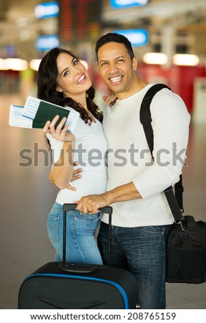 lovely mid age couple at airport - stock photo