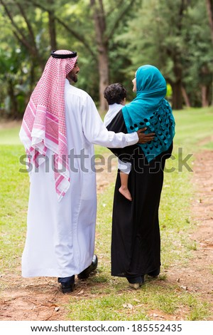 lovely middle eastern family walking at the park - stock photo