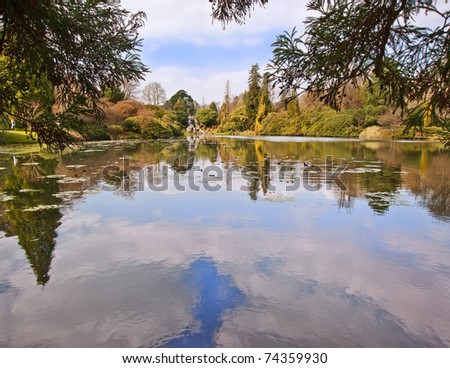 Lovely natural ornamental gardens in Spring with lake and waterfall - stock photo