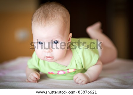 lovely newborn baby in bed - stock photo