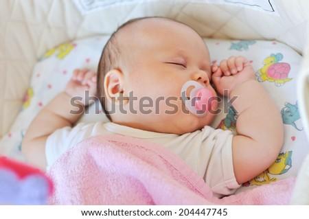 lovely newborn sleeping in the crib - stock photo