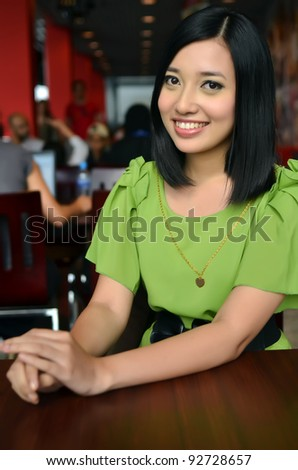 Lovely of young Asian businesswoman smile - stock photo