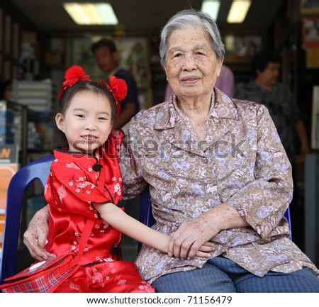 Lovely Old and Kid Asian Chinese woman portrait in home background - stock photo