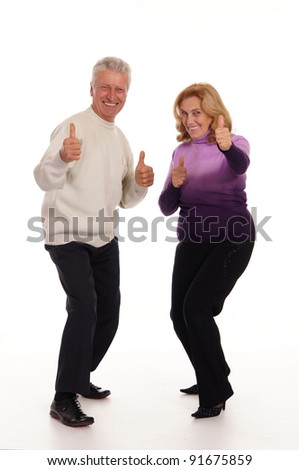 lovely old couple posing on a white