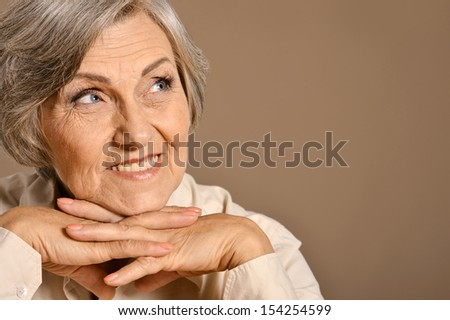 Lovely old woman smiling isolated in studio