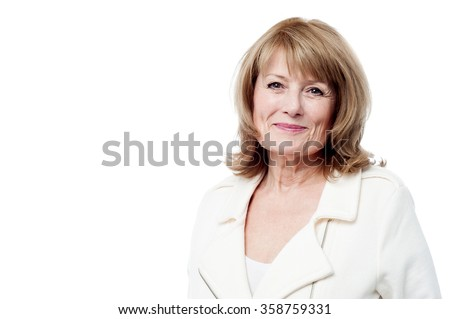 Lovely old woman smiling isolated in studio - stock photo
