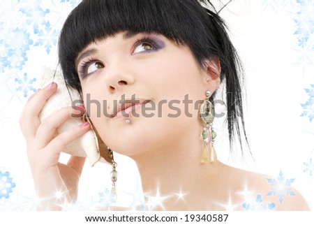 lovely oriental girl with shell and snowflakes - stock photo