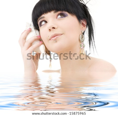 lovely oriental girl with shell in water - stock photo