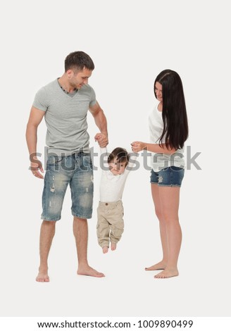 lovely parents play with their son together indoors