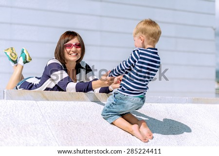 Lovely portrait of a mother and son outdoor - stock photo