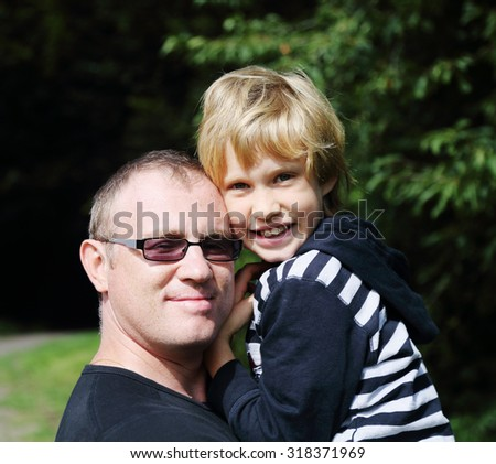 Lovely portrait of father and son - stock photo