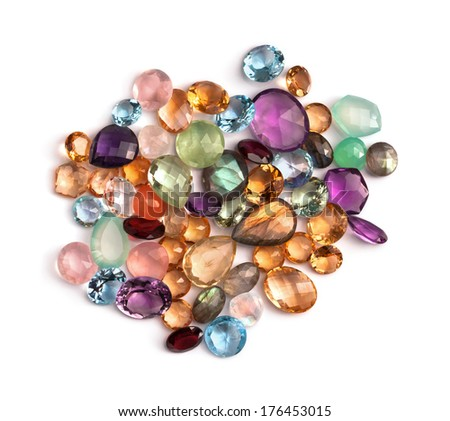 Lovely real colorful gems collection. Many different faceted stones: amethyst, rose quartz, blue topaz, labradorite, garnet, citrine, lemon quartz, moon stone and more. - stock photo