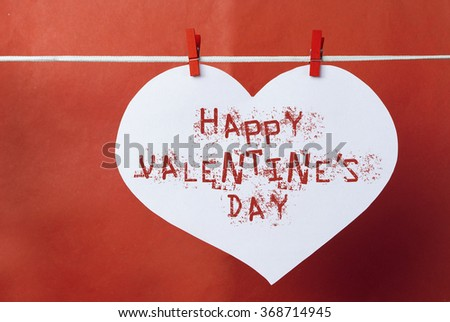 lovely red hearts - big white Heart hanging on the clothesline. On old color background. Romantic date, love,  Happy Valentines Day message.  - stock photo