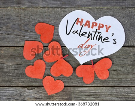 lovely red hearts - big white Heart hanging on the clothesline. Space for info text. On old wooden background. Romantic date, love Happy Valentines Day message. hard Toned image - stock photo