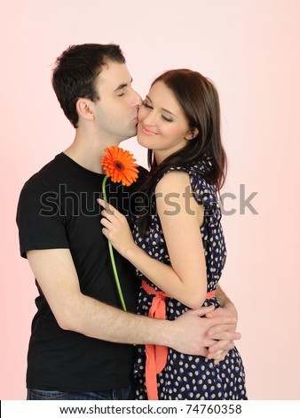 lovely romantic couple with flower embracing - stock photo
