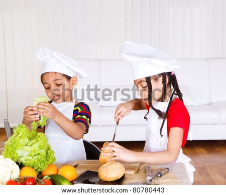 Lovely school aged siblings making sandwich