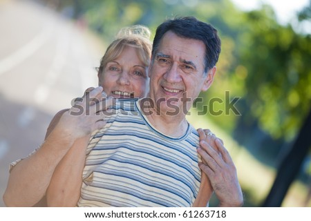 Lovely senior couple in the park