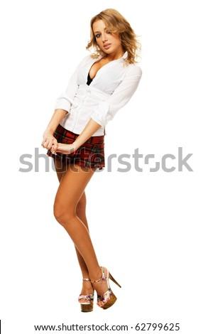 Lovely sexy girl in checkered short skirt on white background - stock photo