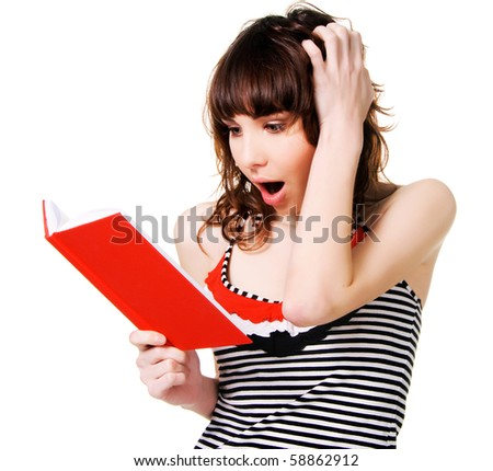 Lovely shocked brunette with a red book on white background - stock photo
