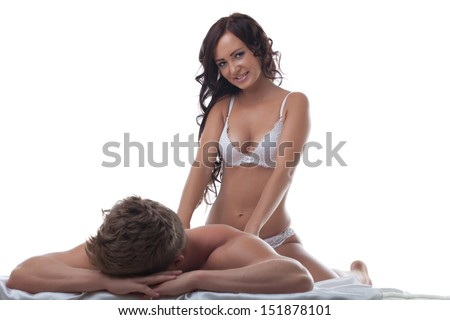 Lovely slim brunette doing massage her lover - stock photo