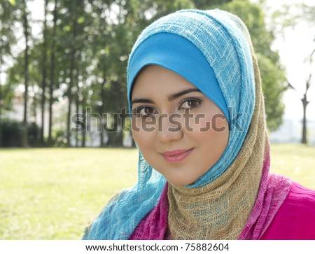 Lovely smile from Muslim girl - stock photo