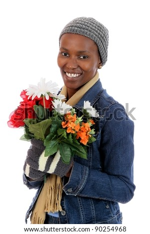 Lovely smiling African woman holding a bunch of flowers - stock photo