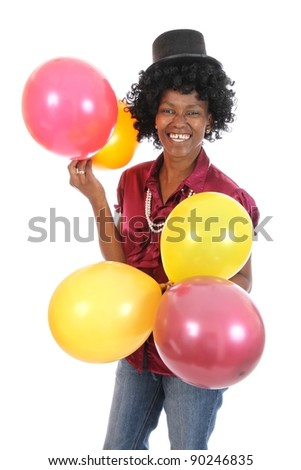 Lovely smiling and happy African woman with party balloons - stock photo