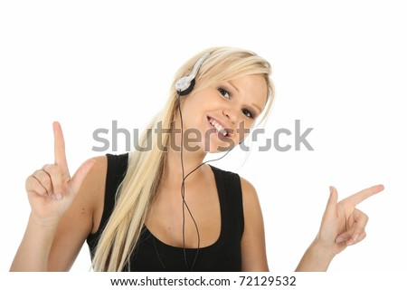 Lovely smiling blond woman enjoying listening to music - stock photo