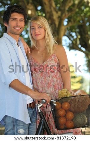lovely smiling couple back from market - stock photo