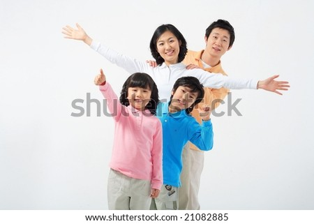 Lovely Smiling Family with hand signs - stock photo