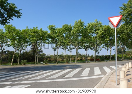 lovely street scene with road sign - stock photo