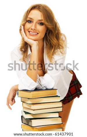 Lovely student girl with a stack of books - stock photo