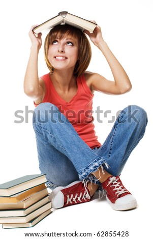Lovely student girl with a stack of books, white background